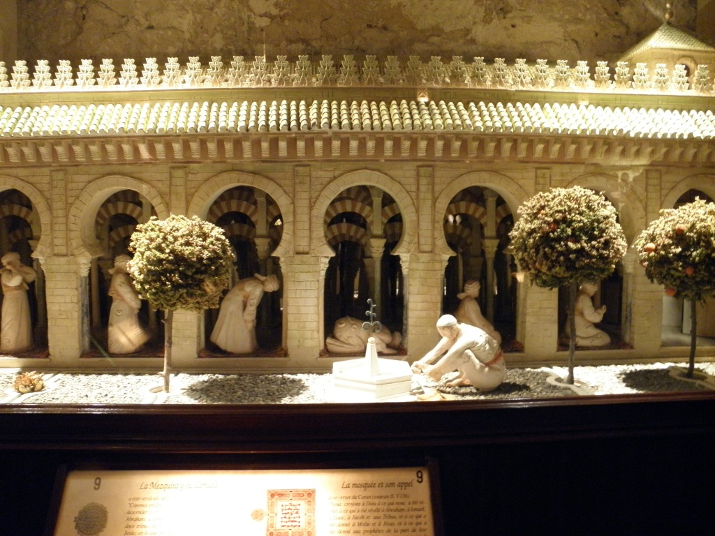 A model of the great masjid of Cordoba and the stages in a person's prayer. The masjid is now a Cathedral and still stands