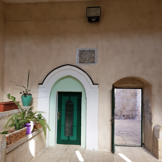 The courtyard of the little mosque right next to the chapel of the ascension. The door to the family's home (who guard her tomb) is here